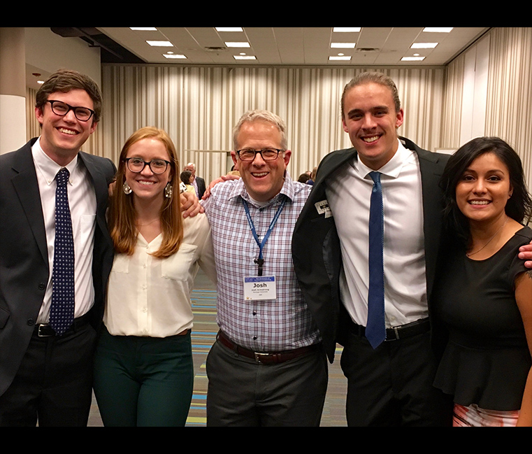 CLP students with Dr. Josh Armstrong at the ILA conference