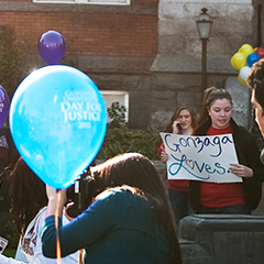 Students hold signs and balloons for Gonzaga University Day of Justice