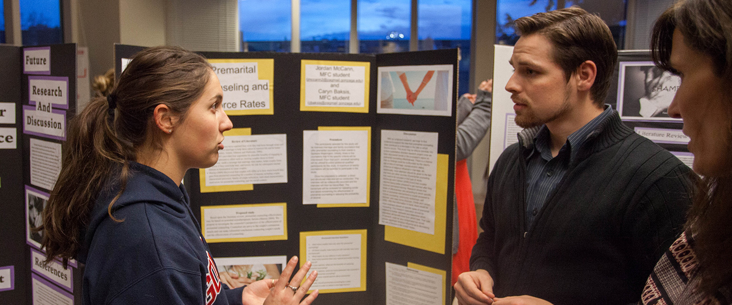 A student presents her research poster