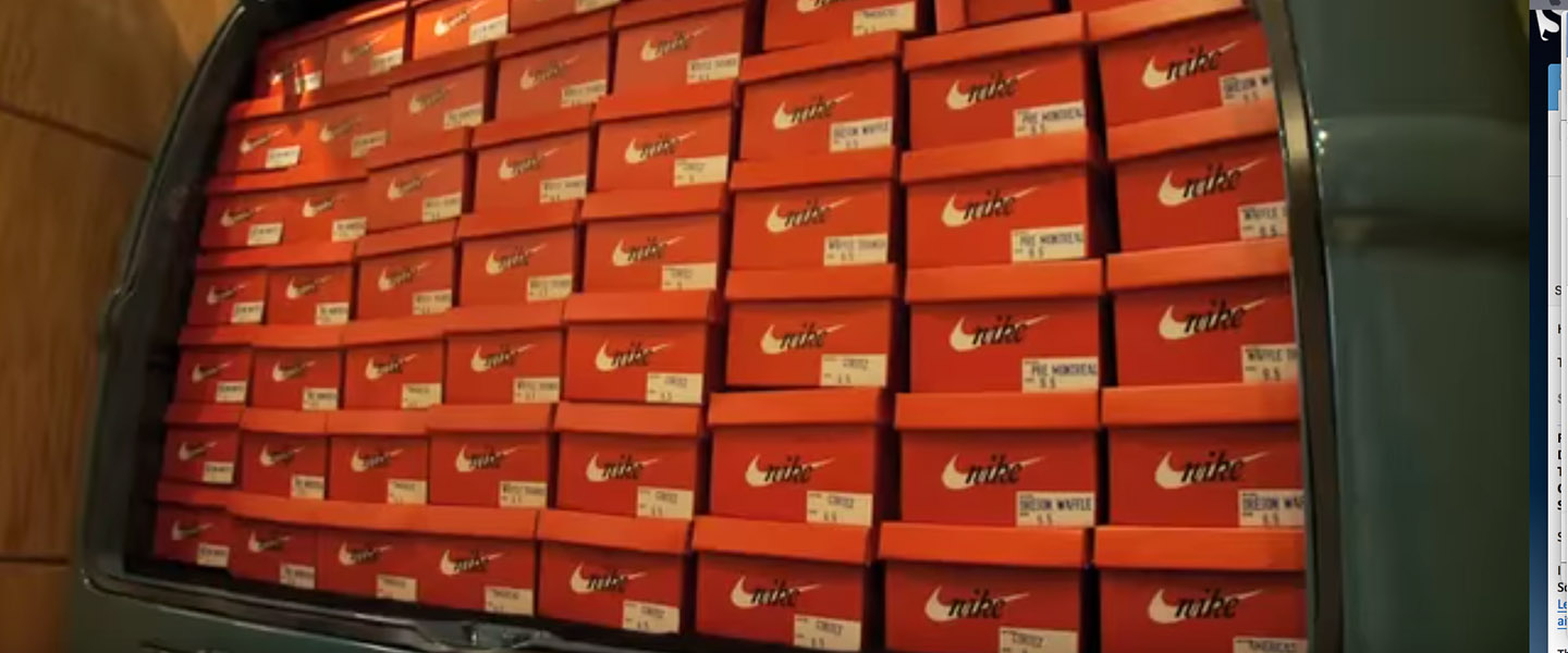 Nike shoe boxes stacked up in a van