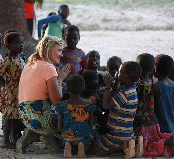 Student with children in Zambia