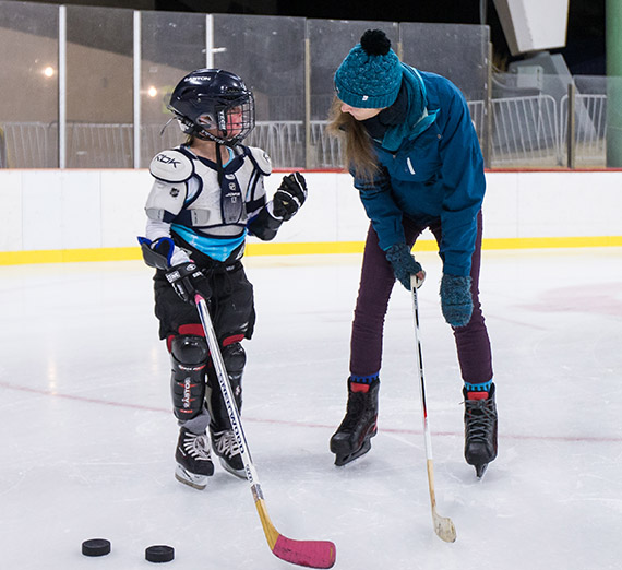 Gonzaga students, working with GU Professor Mark Derby, help youth in the Gonzaga Exceptional Hockey Program at Riverfront Park Ice Arena on Nov. 20, 2015.