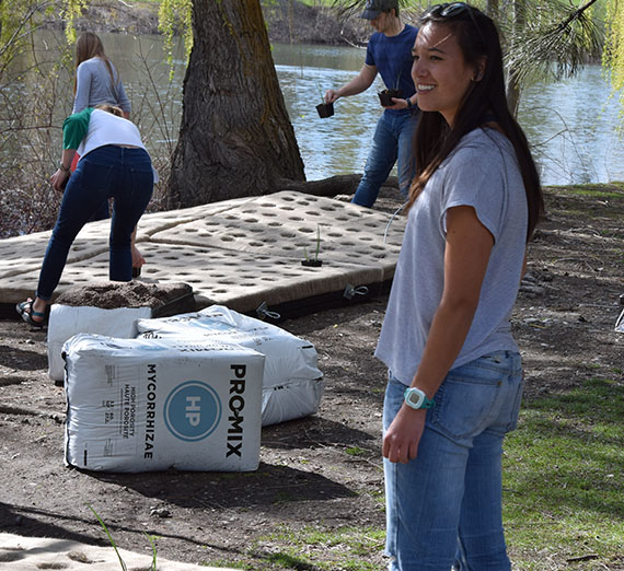 Students setting up a floating wetland in Lake Arthur