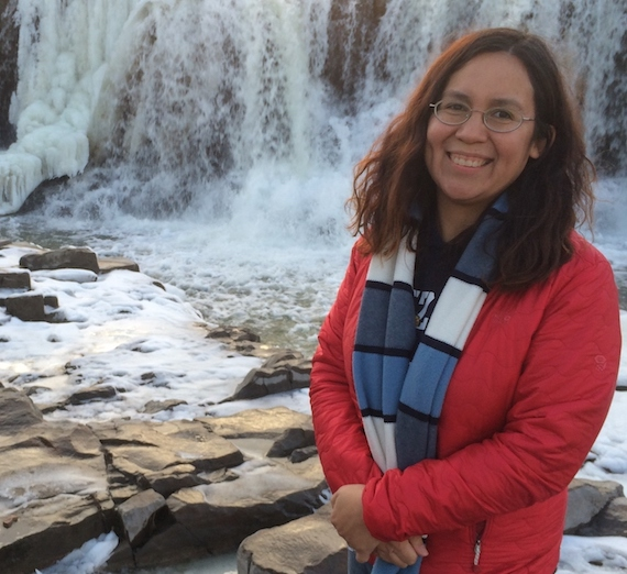 Brenda Velasco standing in front of Sioux Falls