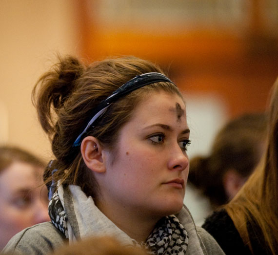 student at ash wednesday mass