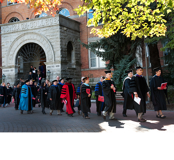 Faculty in academic regalia leaving College Hall in procession
