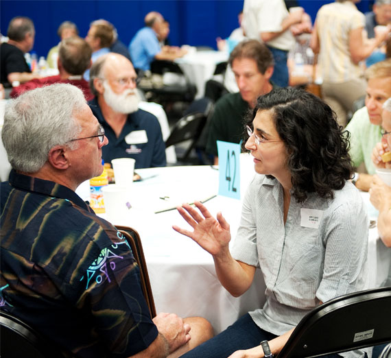 Two Gonzaga University faculty members interact at a faculty conference.