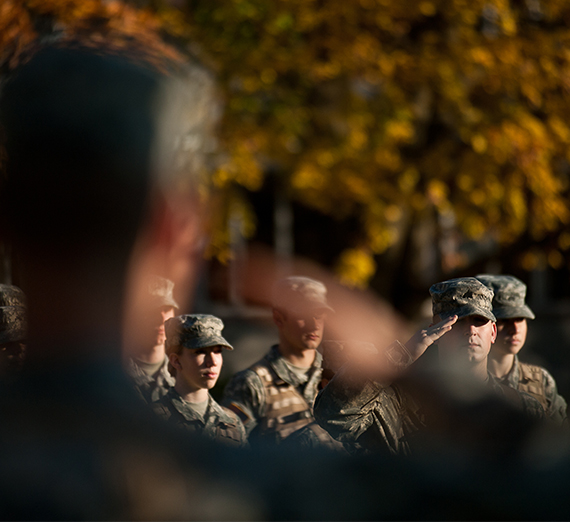 ROTC soldiers saluting.