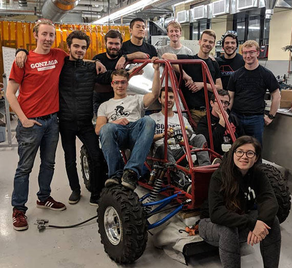 A few of the students of the 2018 build team with their 2018 entry