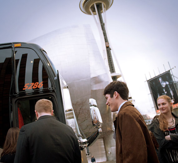 "Gonzaga students board a bus during the Seattle ""Trek"" career development event"