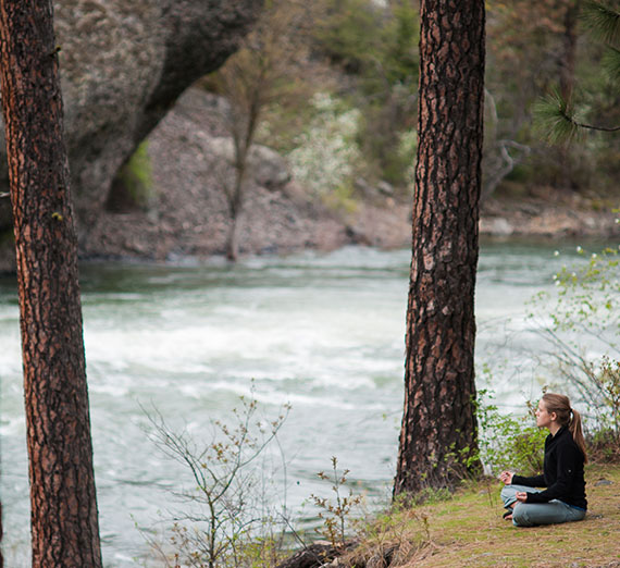 Student sitting by the rivers