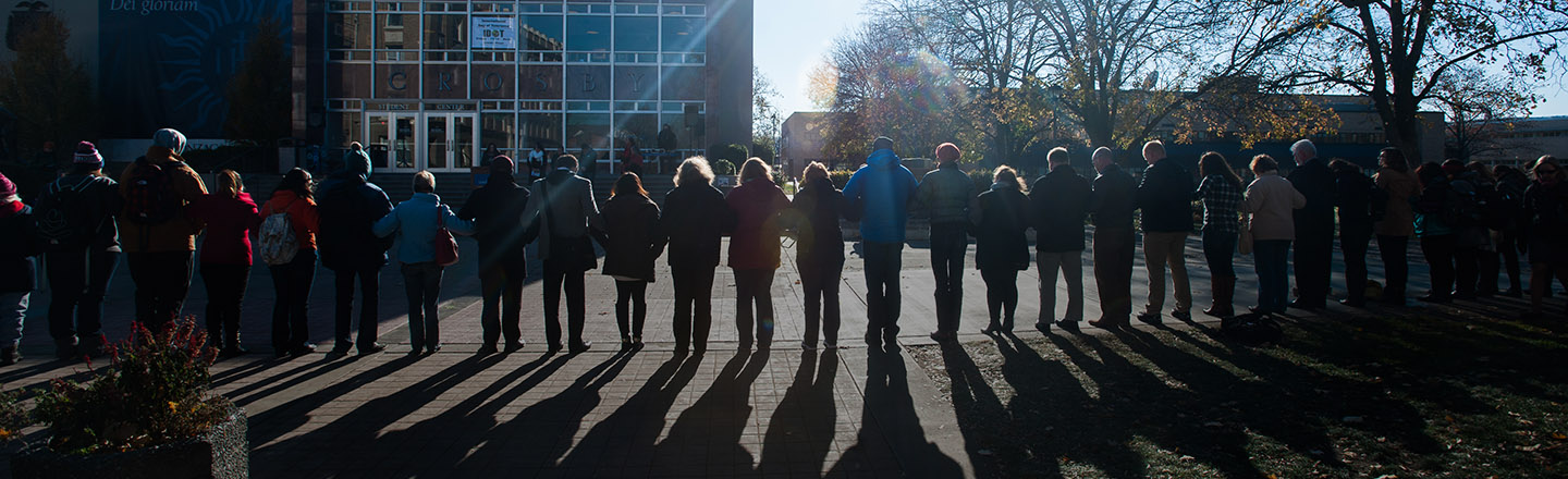 Students and faculty gather outside of the Crosby Center by the wall to recognize International Day of Tolerance.
