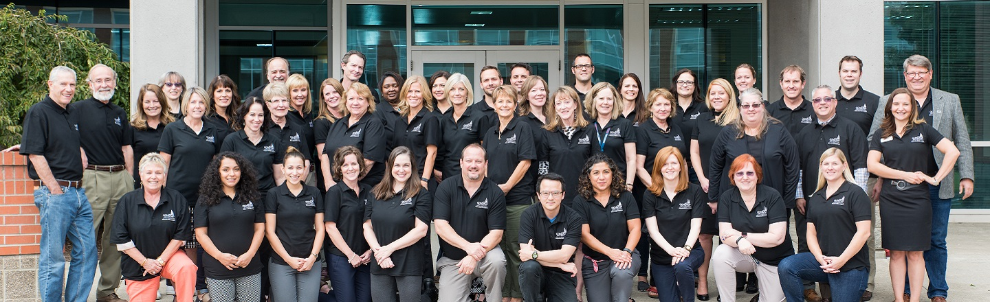 Gonzaga University's school of education faculty poses for a group shot on September 21st, 2016 in front of the Rosauer Center.