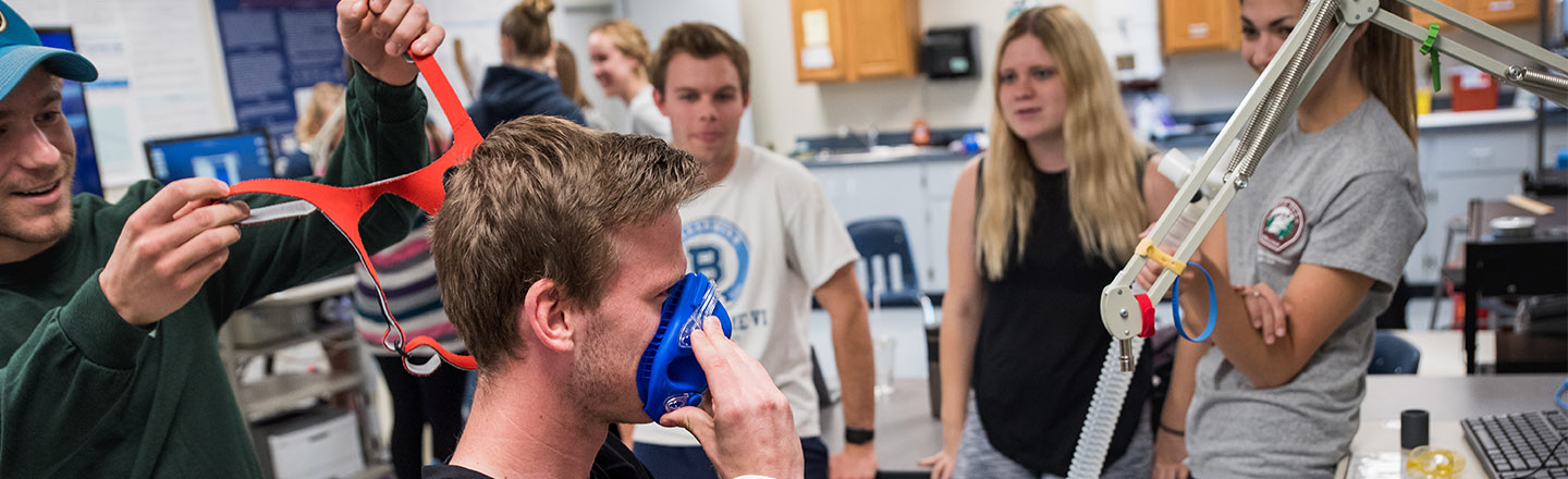 A Human Physiology student puts on a mask