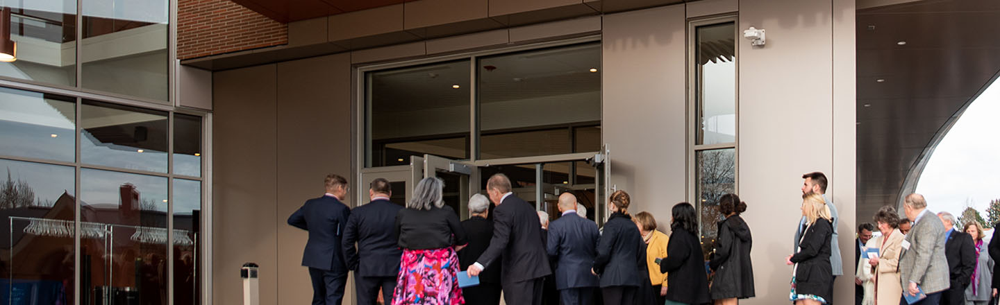 theatre-goers entering the front doors of the performing arts center