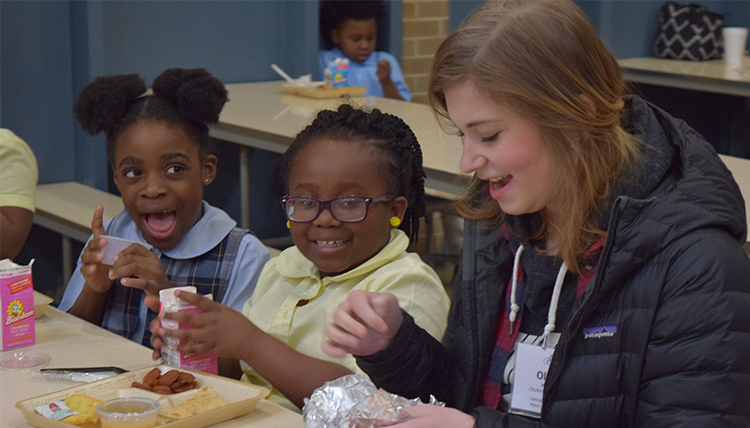Gonzaga student Olivia Moorer with children from Resurrection School in Montgomery Alabama