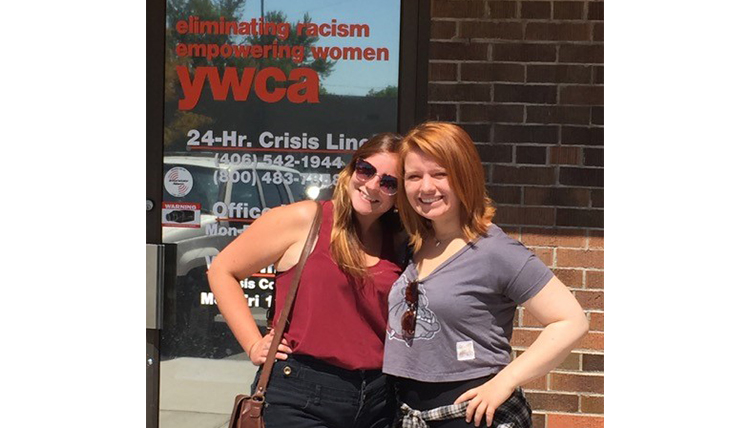 Cat and Liv outside the YWCA crisis center entrance in Missoula