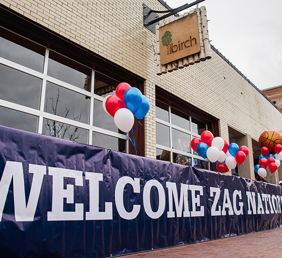 Welcome Zag Nation sign hangs outside The Silly Birch bar in Boise