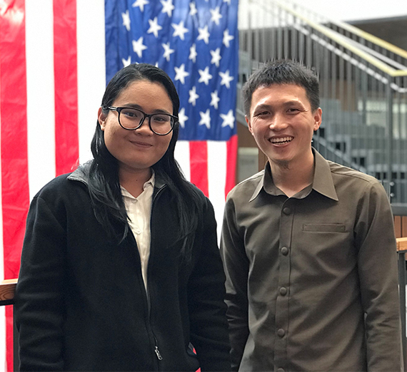 International fellows from Cambodia and Laos pose in front of US flag