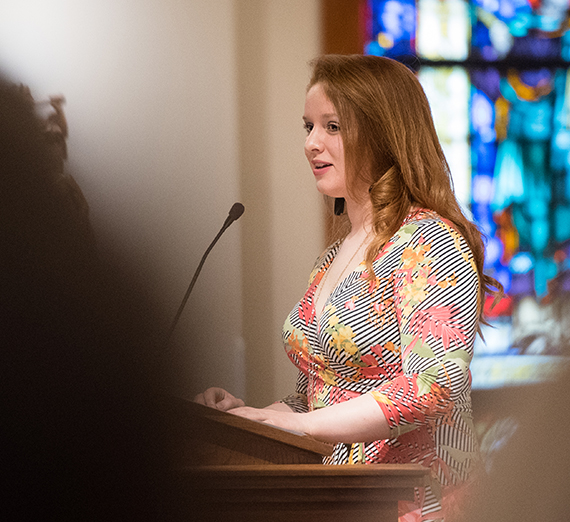 Liv Scheider at podium in student chapel