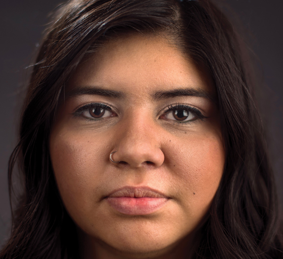 Profile of straightfaced college-aged Latina woman