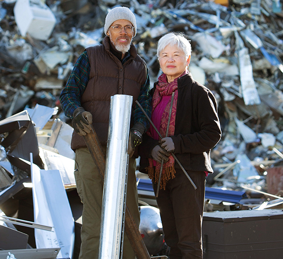 Action and Jackie Jackson pose with scrap metal at one of their recycling sites.