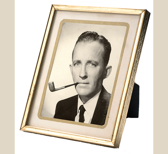 frame with photo of Bing Crosby with pipe