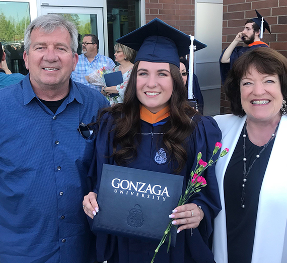 Melissa Keenan on her graduation day with parents