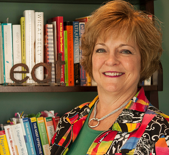 Robyn Holder in front of bookshelf