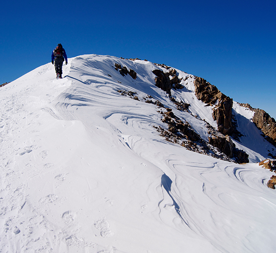Greg Onofrio approaches the peak of Mt. Elbert in the snow.