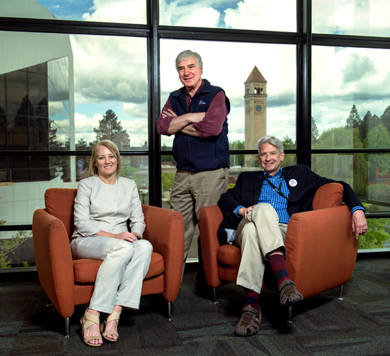 Mike Kobluk, Kevin Twohig, and Stephanie Curran in a building overlooking the Spokane clock tower.