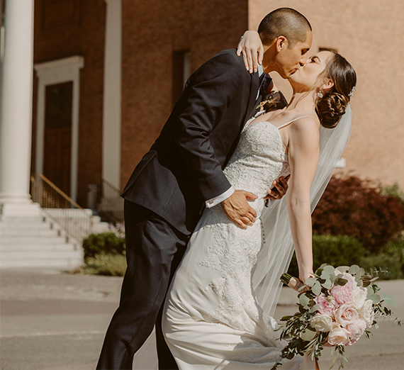 couple kisses outside St Aloysius Church
