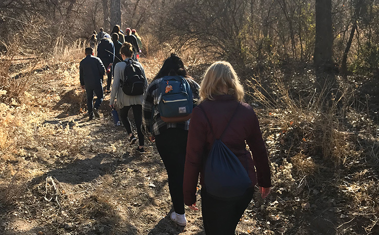 Students walk through the wilderness near the U.S./Mexico border