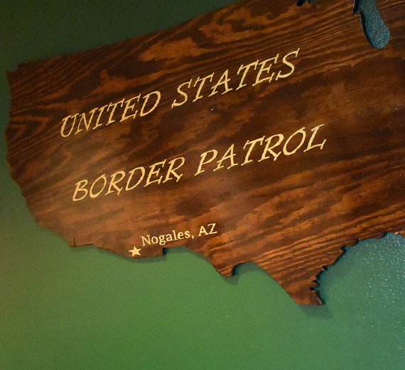 wooden us map with the Nogalez AZ border office marked