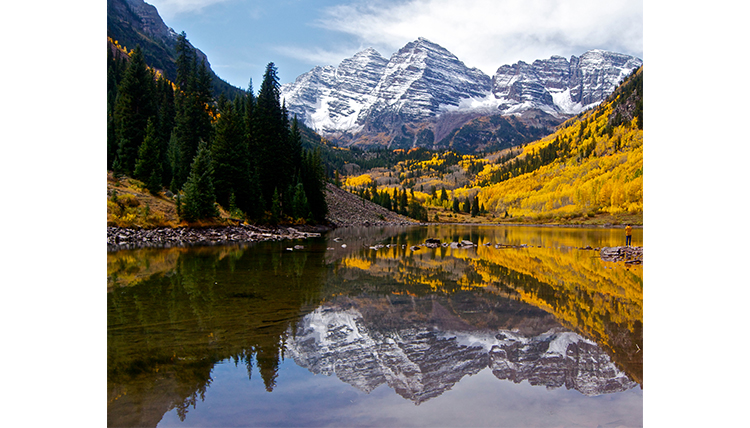 Colorado mountains with lake and fall foliage in the foreground