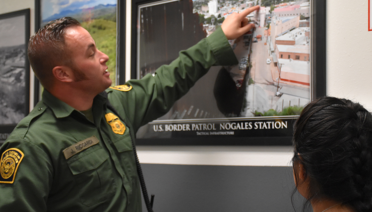 A Border Patrol Agent at the Nogales AZ port of entry visits with Gonzaga students