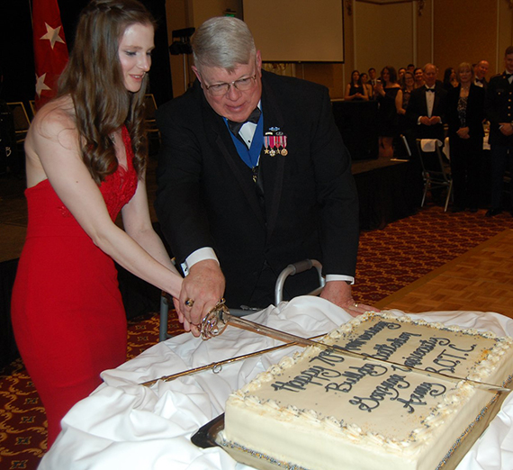 "At the Military Ball on March 23, the youngest cadet in the Battalion, Lindsey Evers (Class of 2021), and the oldest attending program graduate, retired Col. William ""Fred"" Aronow (Class of 1967), cut the cake with a special sabre sword."