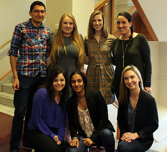 Standing (from left): Ryne Smith, Micaela Meadows, Colleen Penny, Rebecca Smith.  Front row (from left): Sara Duross, Gurpreet Dhatt, Lesley Gangelhoff. Photo courtesy GU Law.
