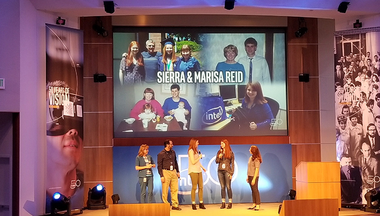 The Reid sisters are center stage holding microphones during Intel's 50th anniversary celebration in July. Marisa (left) faces Sierra. Their presentation was live-streamed to the company's 100,000-plus employees. (Photo courtesy Sierra Reid)