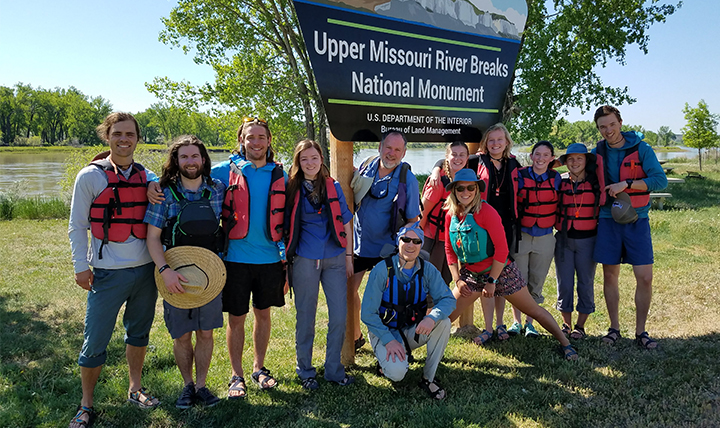 The group of students and staff pose in front of the Missouri Breaks sign