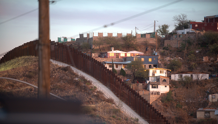 the steel wall diving the town of Nogales across the U.S.-Mexico border