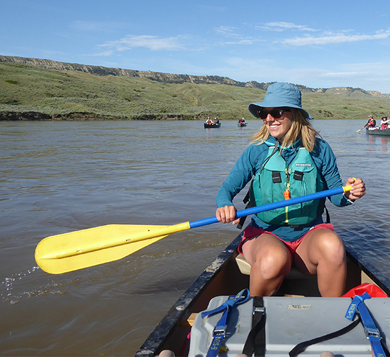 Student paddling canoe on the Missouri River