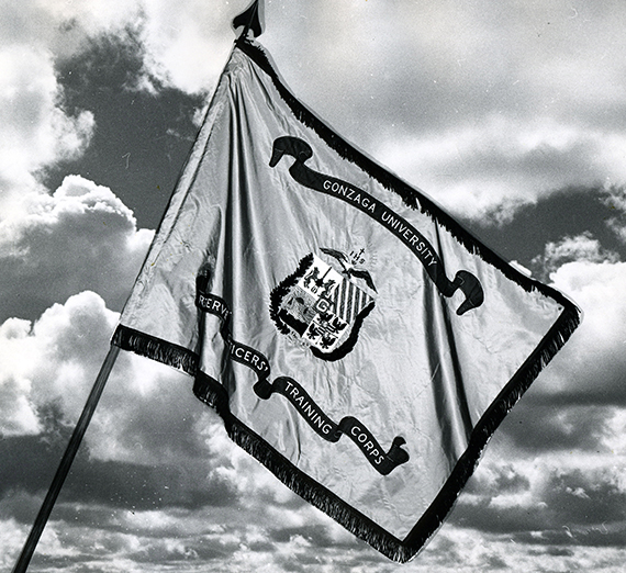 Gonzaga ROTC Standard flag waving in front of clouds
