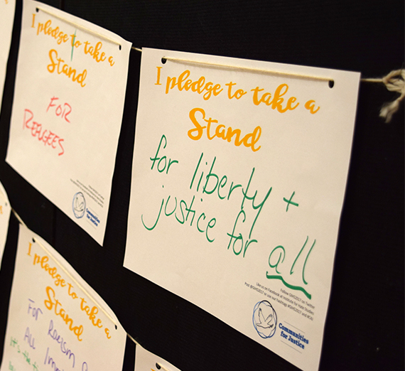signs with handwritten pledges for justice