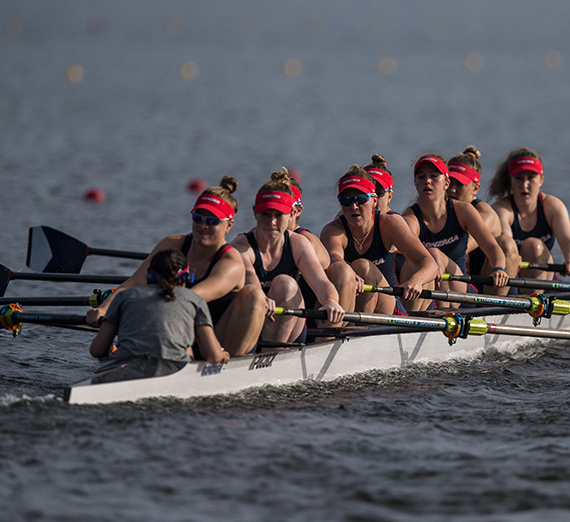The women's crew team paddles an 8-woman boat in the NCAA Championships.