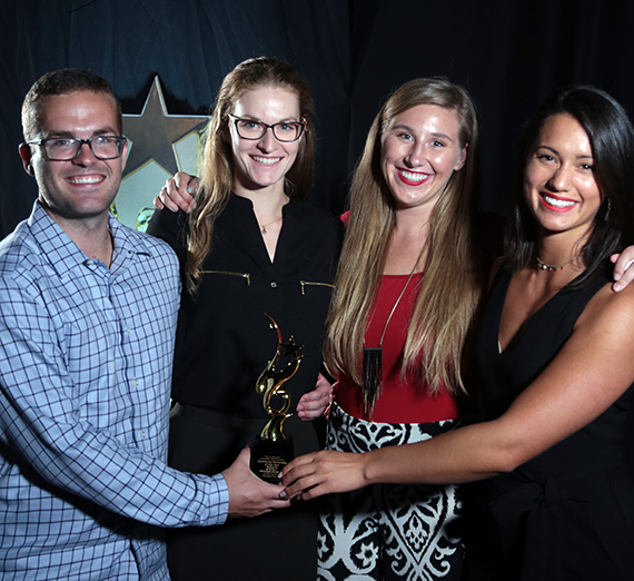 Accepting the award on behalf of Gonzaga were alumni (from left) Tom Scott, Caitlin Pallai, Laura Winje and Melody Mileur. They participated in the program and now hold professional positions in Williston. (Photo courtesy Williston Economic Development)