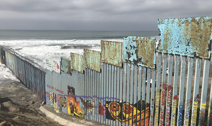 The Us-Mexico border wall extends into the Pacific Ocean.
