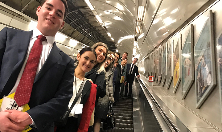 Students pose on the escalator in the London metro.