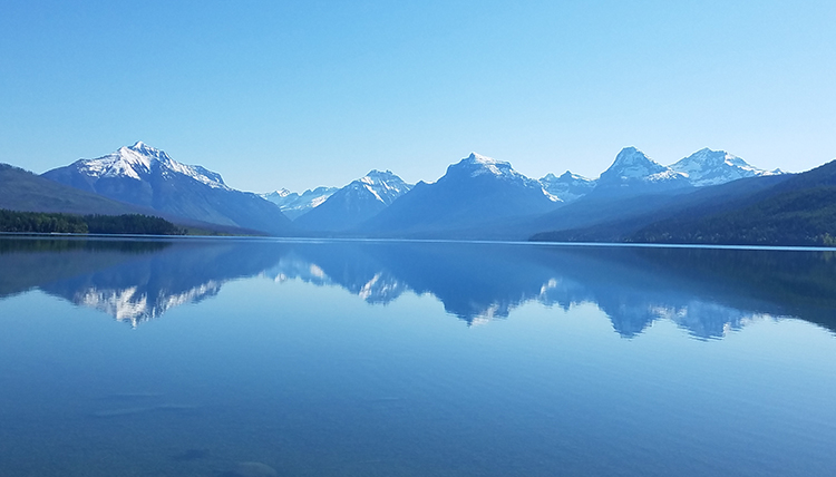 reflection of mountains on Lake McDonald in Montana