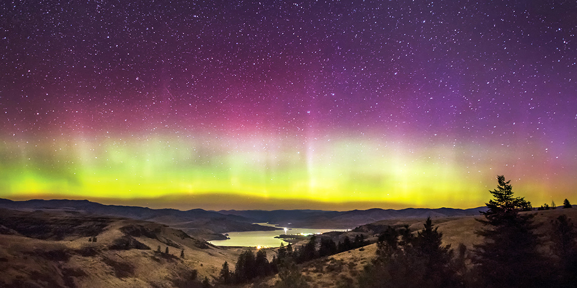 The Aurora Borealis hovers over the Columbia River and Keller Ferry in Eastern Washington.